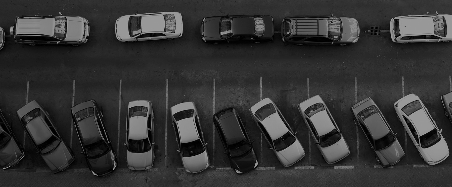 Overhead view of cars parked in a long term parking lot owned by Premium Parking